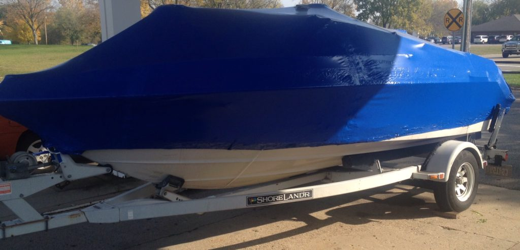 speed boat shrink wrapped for winter